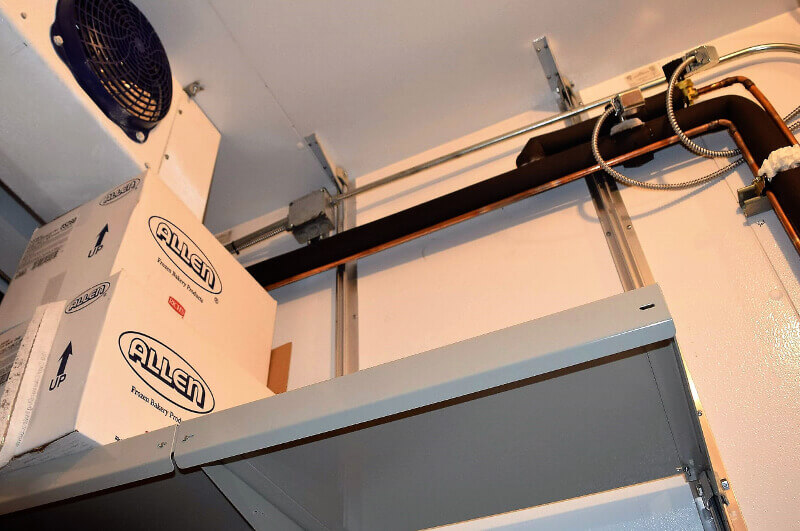 Ceiling Bracket Placement for Walk-In Cooler Shelving System