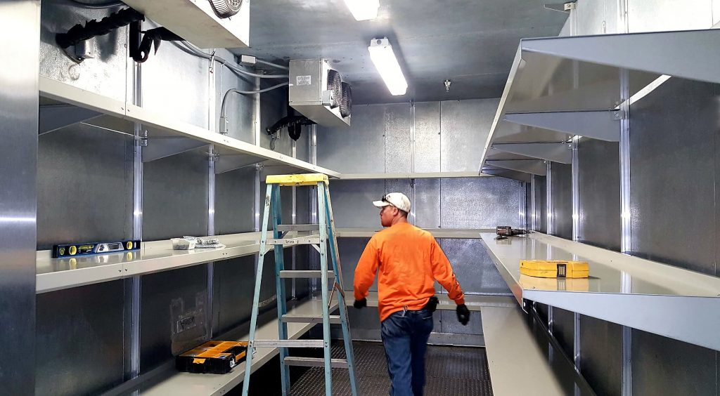 Professional Walk-in Cooler Shelving Installation in Process