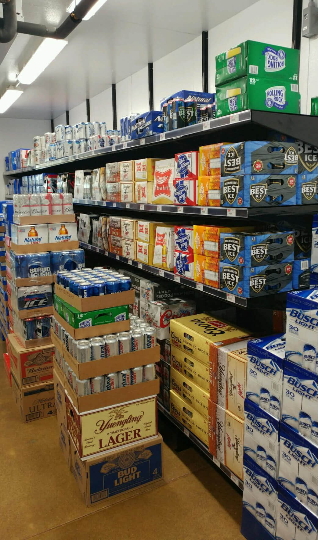 Wall-Mounted Beer Cave Shelving by E-Z Shelving Systems